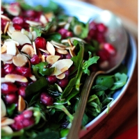 Watercress salad with almonds and pomegranate.